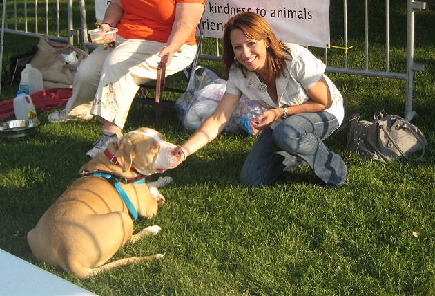 Jamie Buehrle pets Truman, a very special dog sponsored by the Buehrles.  See Truman's story above.